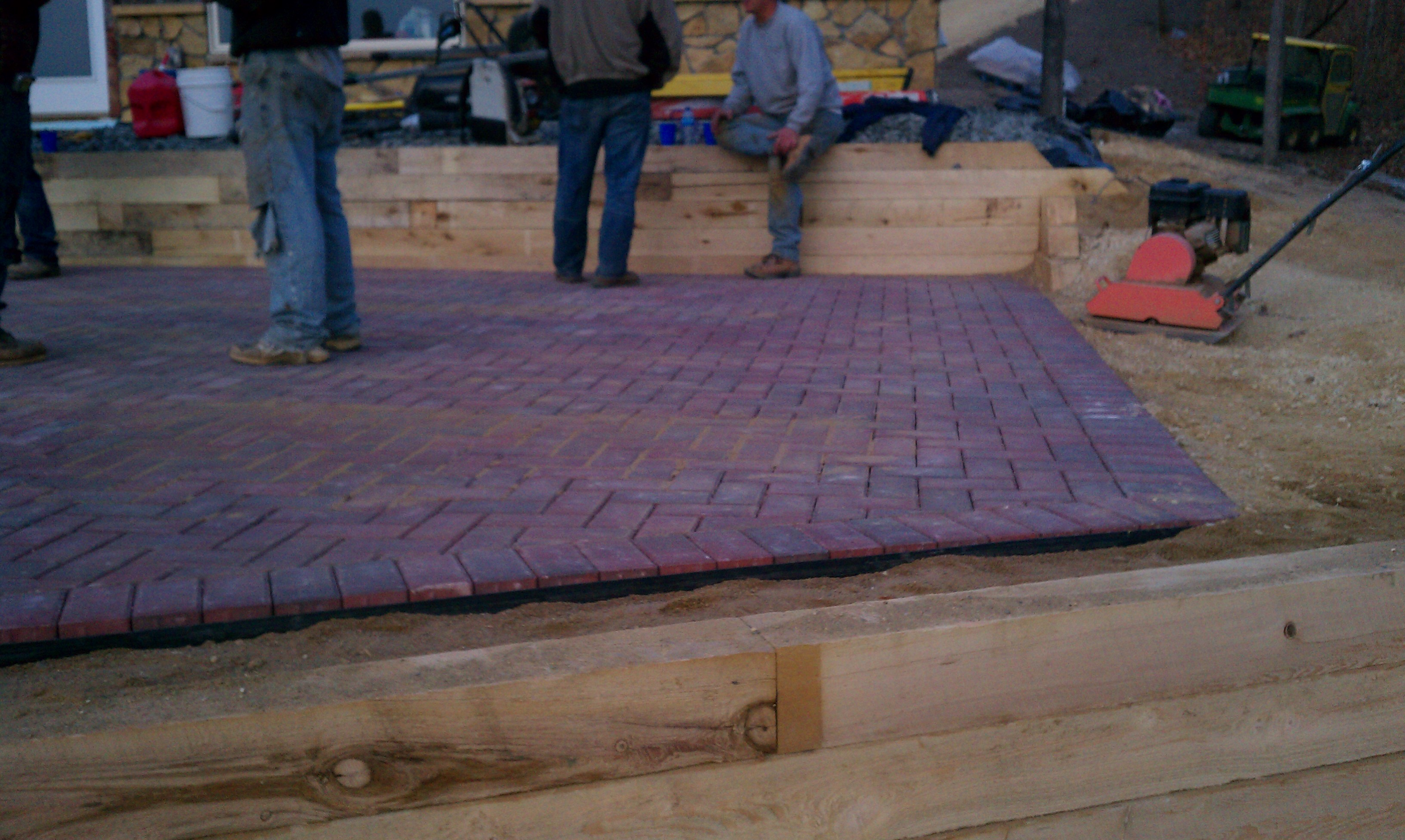 Paver Patio On Timber Wall Ejk Custom Remodeling